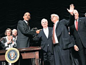 Obama and former senators sign Frank-Dodd Act; image courtesy of Pablo Monsivais, AP