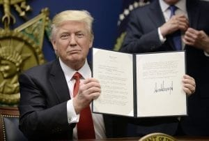 US President Donald Trump signs Executive Orders in the Hall of Heroes at the Department of Defense Friday, Jan. 27, 2017 in Arlington, Va. (Olivier Douliery/Abaca Press/TNS)