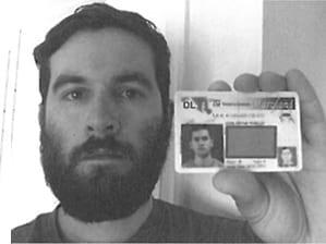 John Rivello holding driver's license.