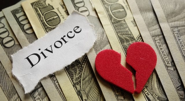 Picture of money with a paper saying divorce and a broken heart