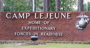"Sign saying ""Camp Lejeune, home of expeditionary forces in readiness."""
