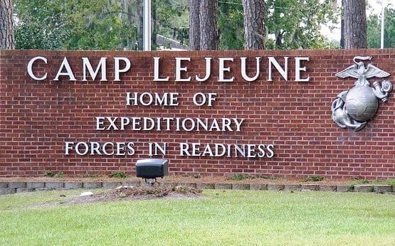 """Sign saying """"Camp Lejeune, home of expeditionary forces in readiness."""""""