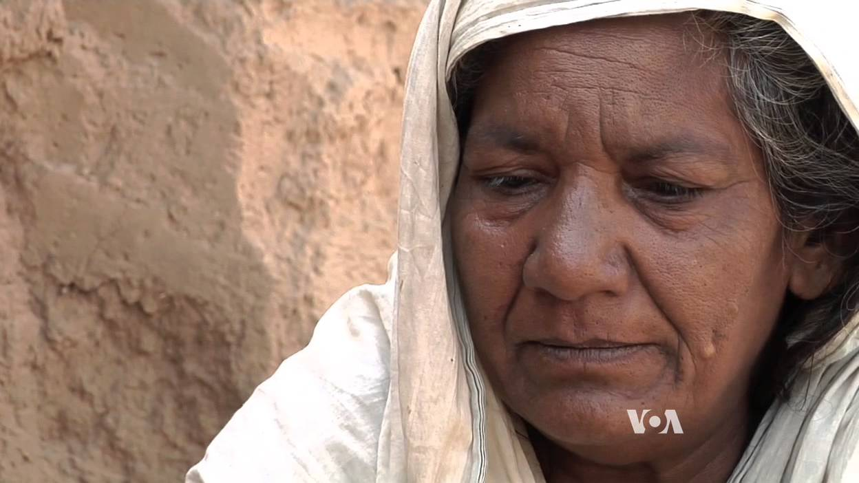 A Pakistani woman held in debt slavery talks about her situation.