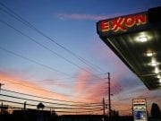 Exxon-Mobile gas station with sunset in the background.