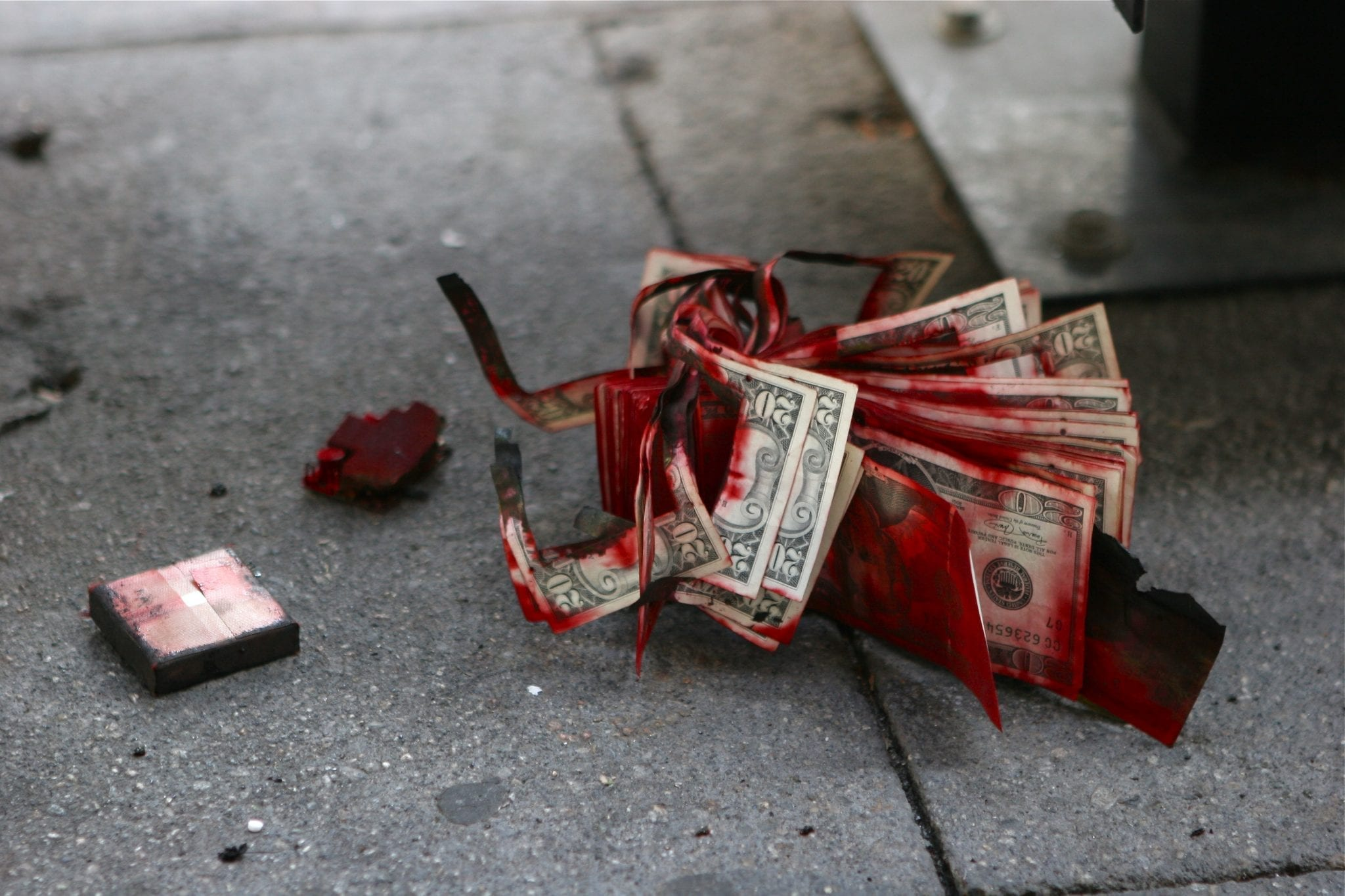 Aftermath of a Bank of America robbery. The dye pack exploded and the stack of 20s were abandoned on the sidewalk. Image by Colin Brown, CC BY 2.0, via Wikimedia Commons, no changes.