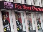 Image of Fox News posters displayed on the News Corp. headquarters building in Midtown Manhattan