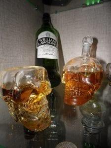 Scotch whiskey in skull-shaped glasses; image via Pxhere, CC0.