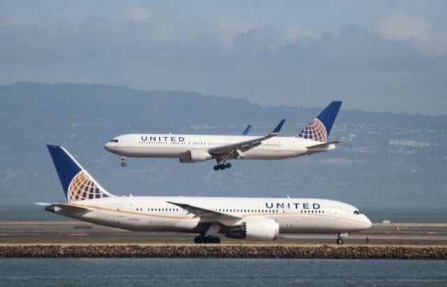 United Airlines planes taxiing for departure and landing.