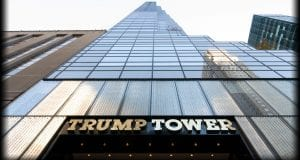 A view of Trump Tower in Midtown Manhattan taken from the street and angled upwards to the top of the building