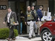 FBI agents leave Attar's office following a search