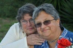 Lead plaintiff Jacqueline Cotes with wife.