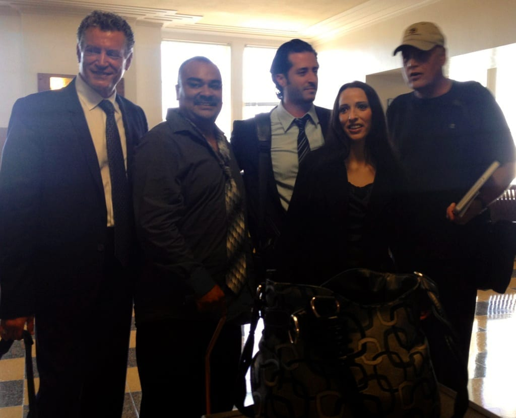 Angel Mendez and his wife, Jennifer Garcia Mendez, with their attorneys