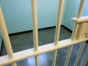 Bars on a cell; image by www.JobsForFelonsHub.com, via Flickr, CC BY 2.0, no changes.
