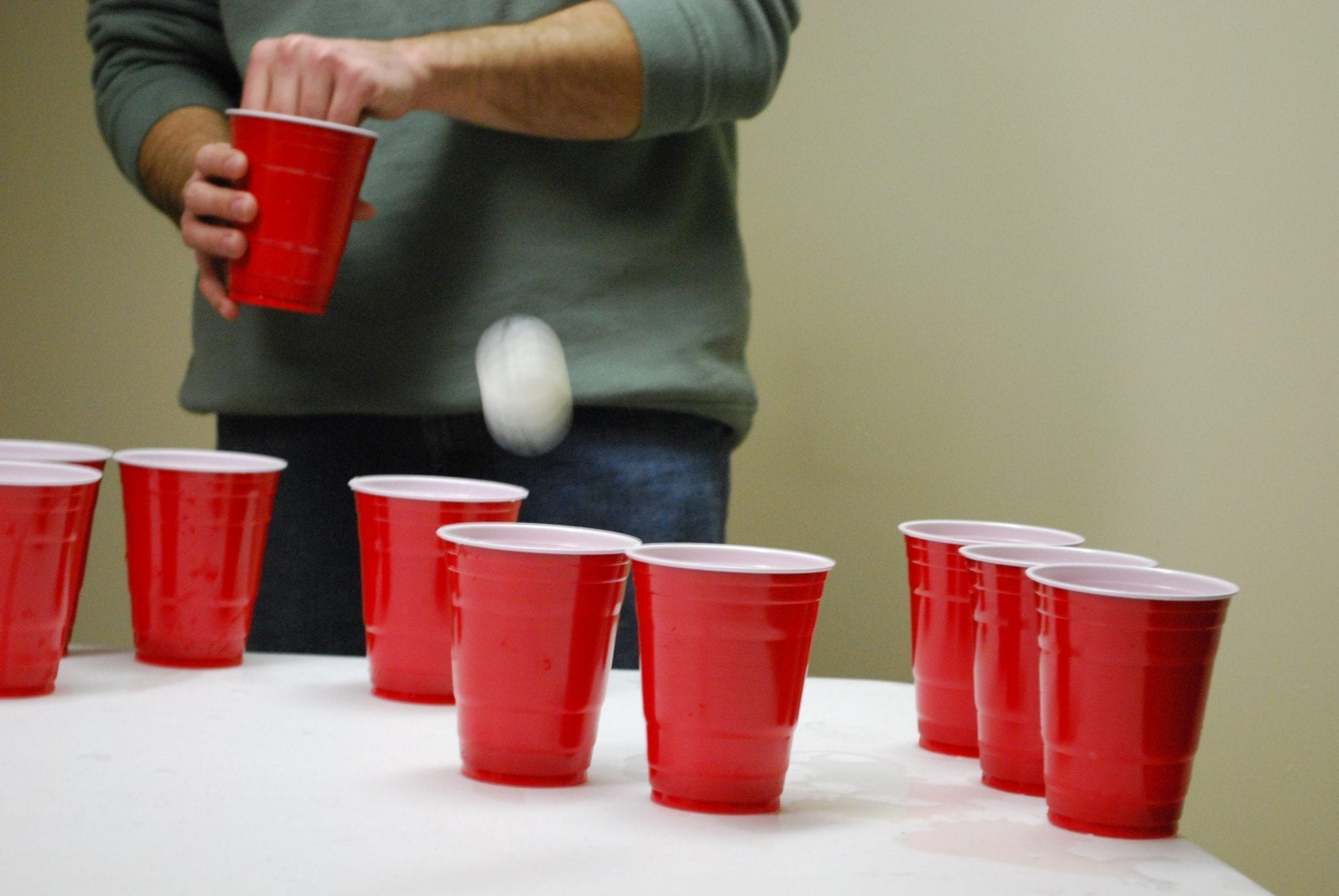 Beer pong, a drinking game commonly played at frat parties; image by Laura LaRose, via Flickr, CC BY 2.0, no changes.