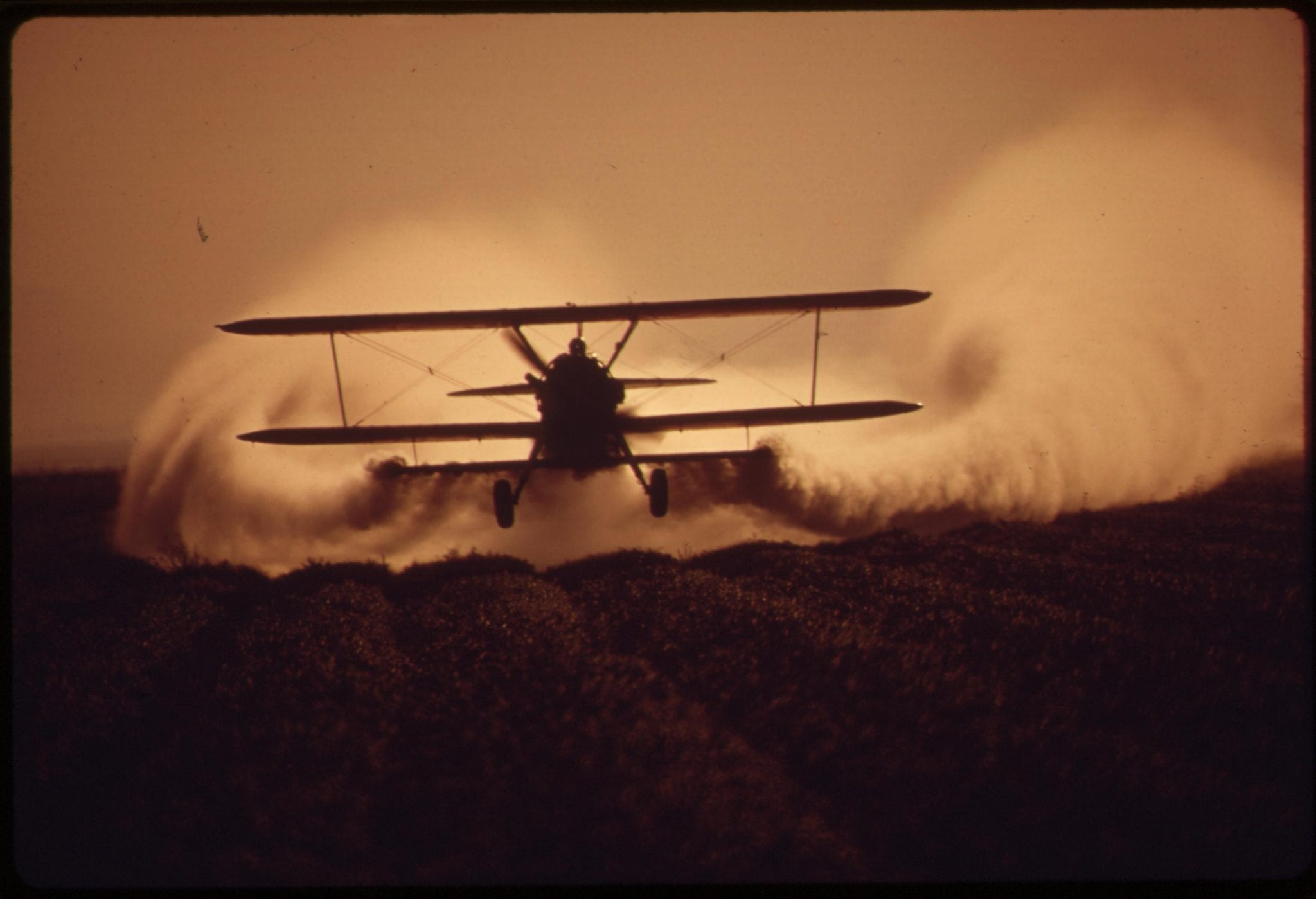 Crop dusting; image by Charles O'Rear/The U.S. National Archives, via Flickr, Public domain.