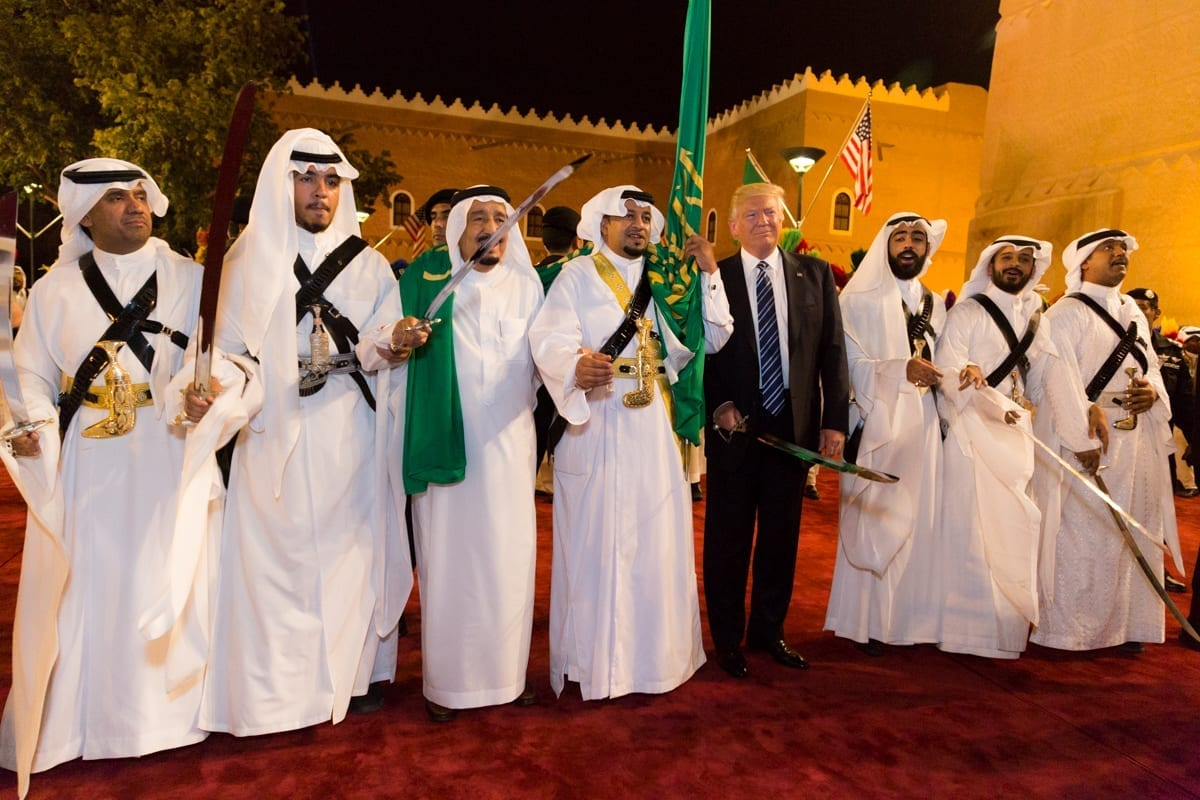 Saudi Arabia's King Salman bin Abdulaziz Al Saud (2nd L) welcomes U.S. President Donald Trump to dance with a sword during a welcome ceremony at Al Murabba Palace in Riyadh, Saudi Arabia May 20, 2017. Image by The White House from Washington, DC (President Trump's Trip Abroad), Public domain, via Wikimedia Commons.