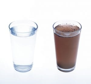 Glasses of clean and dirty water; image by Aqua Mechanical, via Flickr, CC BY 2.0, no changes.