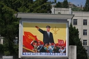 An example of a North Korean propaganda (not the one allegedly stolen by Otto Warmbier); image by Roman Harak, CC BY-SA 2.0, via Wikimedia Commons, no changes.