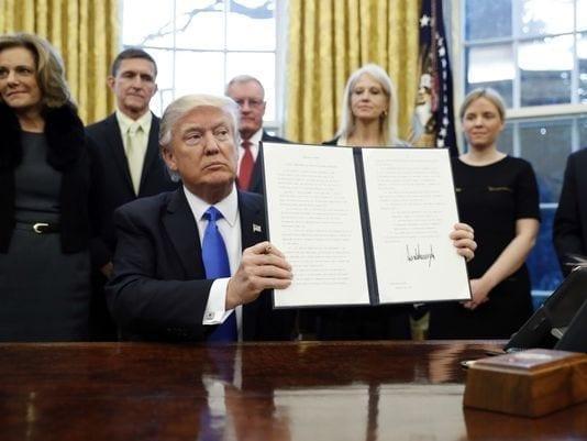 Donald Trump with executive order