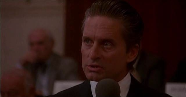 """A still from Gordon Gekko's """"Greed is Good"""" speech from the movie Wall Street, where he speaks about the moral justification of capitalism."""