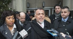 Attorney Nabih Ayad answers questions outside a Detroit courthouse