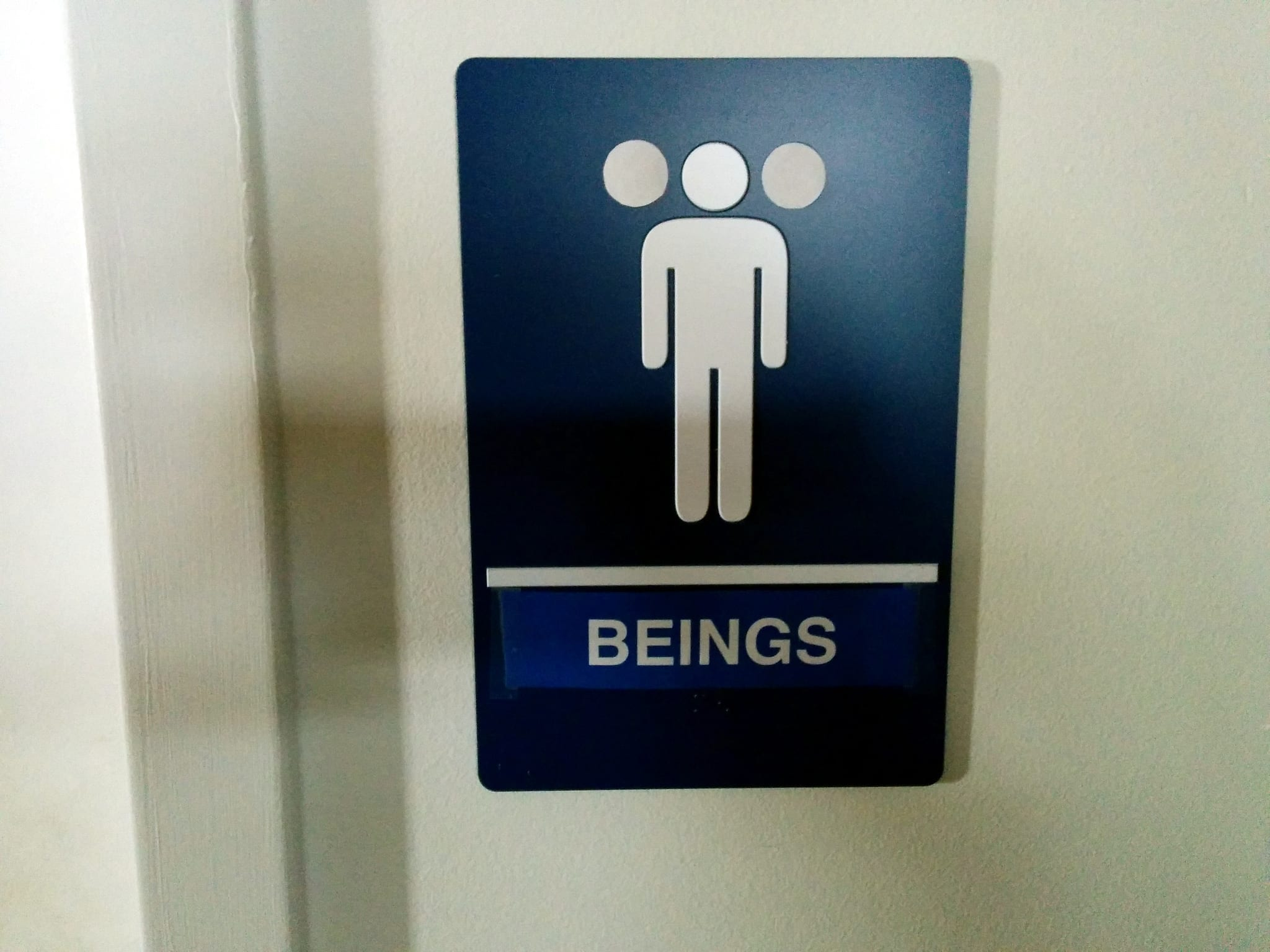 Nongendered toilet sign 2, Electronic Frontier Foundation, California, USA; image courtesy of Cory Doctorow, via Flickr, CC BY-SA 2.0, no changes made.