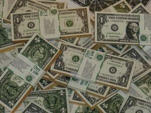 Bundles of U.S. paper money; image courtesy of www.pxhere.com, via CC0.
