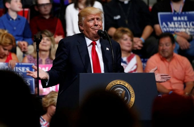 Trump holds a rally with supporters at an arena in Cedar Rapids, Iowa
