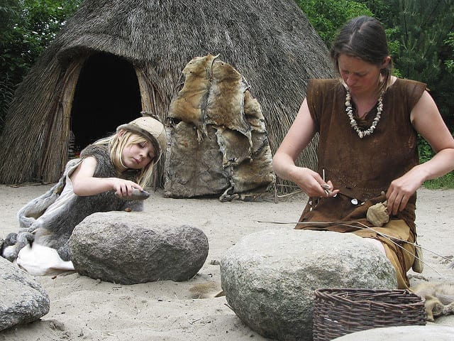 A hunter-gatherer mother and daughter at camp.
