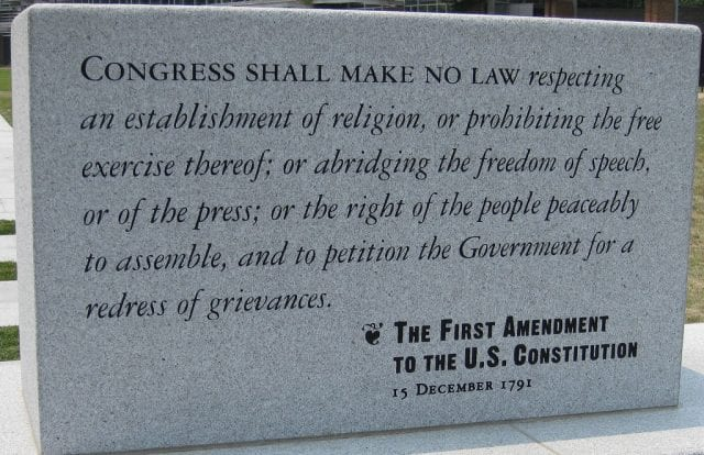 A stone tablet bearing the words of the First Amendment.