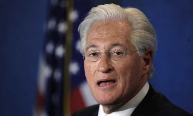 Marc Kasowitz with American flag in background
