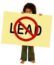 Image of a Child Holding Sign with the Word 'Lead' Crossed Out