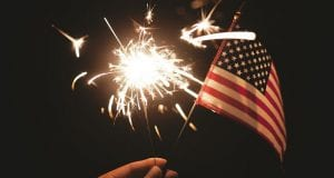 Image of a Firework and American Flag