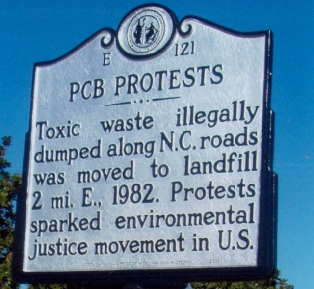 A Historic Landmark sign describes North Carolina PCB protests as the birthplace of the environmental justice movement.
