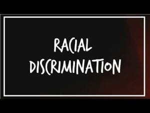 Words 'Racial Discrimination' written in white against black background