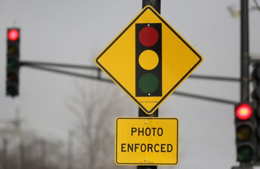 Image of a Red Light Camera Warning Sign