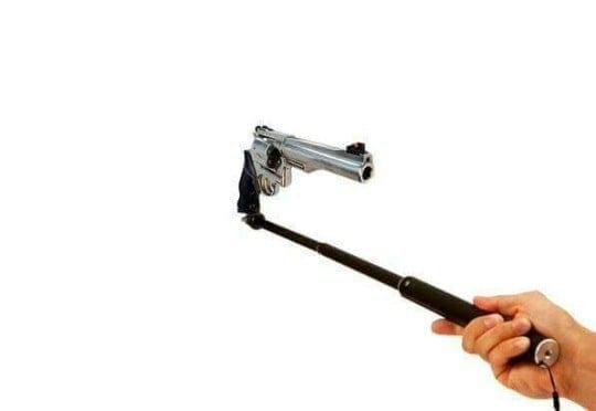Felon Fires Gun While Taking Selfie at Strip Club