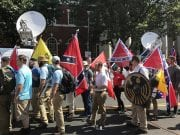 """Alt-right members preparing to enter Emancipation Park holding Nazi, Confederate, and Gadsden """"Don't Tread on Me"""" flags."""