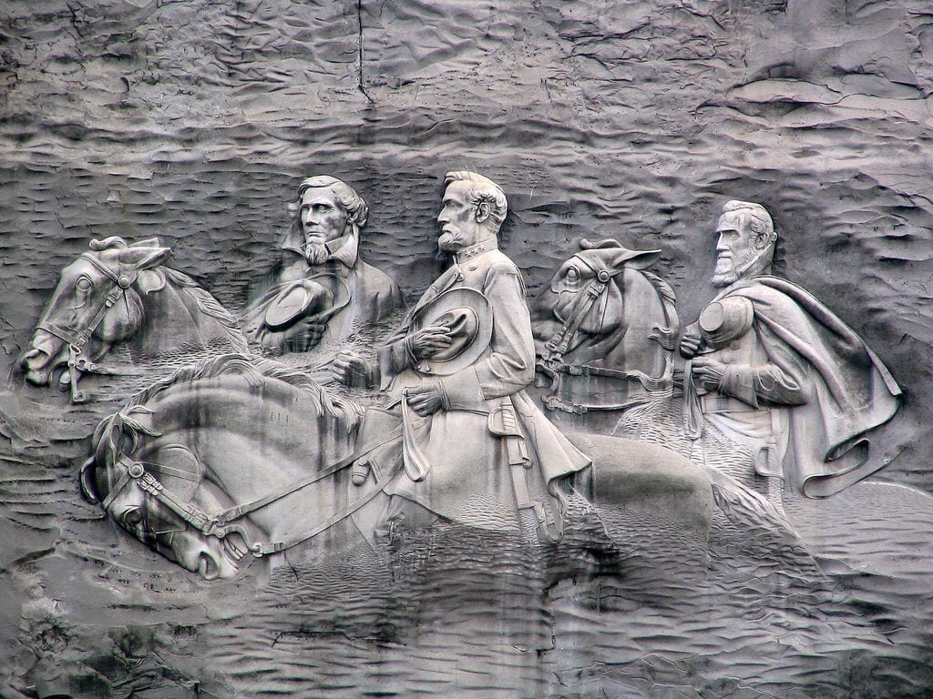 A monumental carving on the flat side of Stone Mountain near Atlanta, depicting Confederate heroes: Jefferson Davis, Robert E. Lee, and Stonewall Jackson.