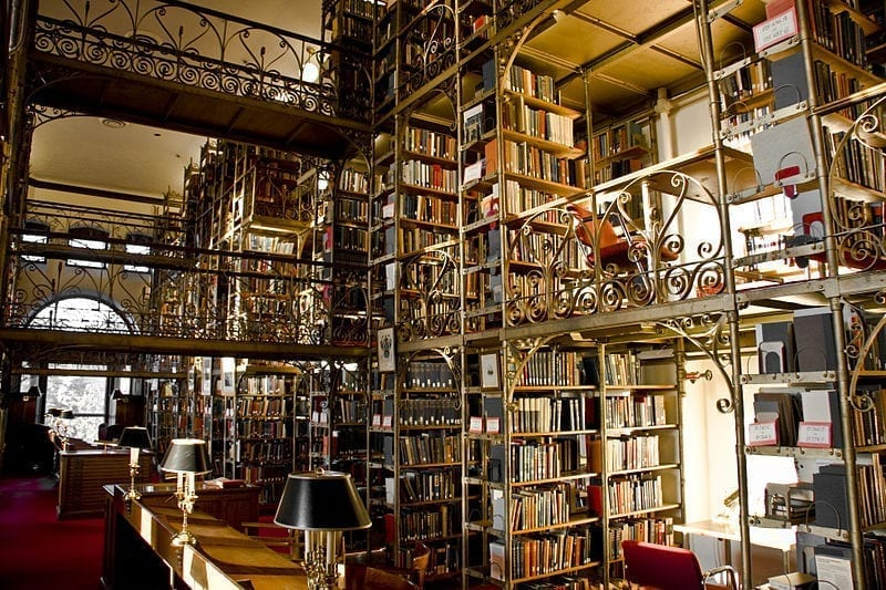 Cornell University's beautiful, multi-tiered library, with shelves of books and nooks to sit in and read.
