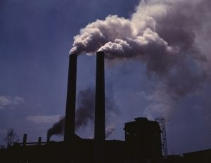 Smokestacks from a wartime production plant, World War II; image courtesy https://en.wikipedia.org.