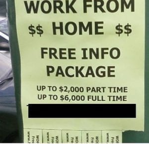 "A ""work from home"" sign hanging in public."