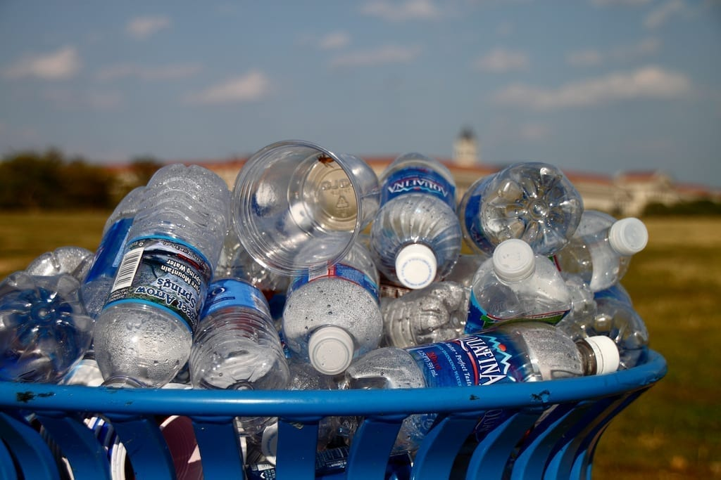 Recycling bin overflowing with water bottles, on the National Mall in Washington, DC.