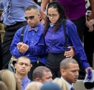 Image of Angelo and Sayyida Mileto Leaving Their Son's Funeral