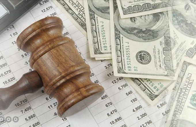 Gavel and money; image courtesy of www.lexmachina.com.