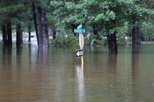 Hurricane Harvey flooding and damage; photo by Jill Carlson (jillcarlson.org), CC BY 2.0, via Wikimedia Commons, no changes made.