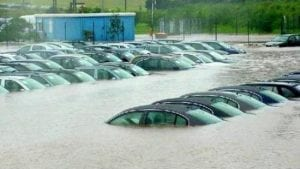 Several flooded vehicles; image courtesy of www.zerohedge.com.
