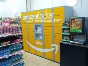 Cheerful yellow Amazon lockers inside a Manhattan store, where shoppers can pick up their Amazon purchases.
