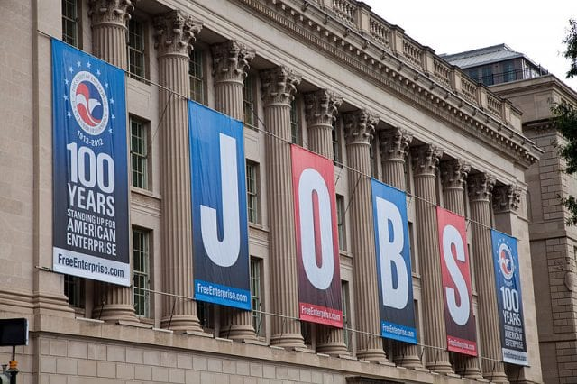 The U.S. Chamber of Commerce building, draped with banners that spell out the word JOBS.