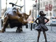 Image of Fearless Girl Challenging Wall Street's Charging Bull